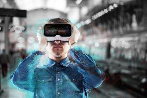 Man wearing virtual reality goggles. Subway station.