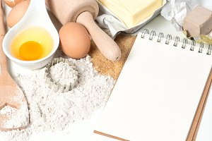 Recipe book and baking ingredients
