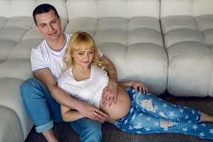 pregnant woman sitting with her husband