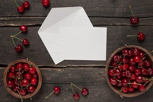 Empty white card with cherry berries