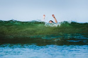 Young woman in wave