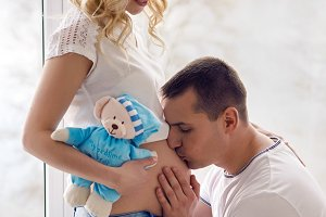 pregnant girl standing with her husband