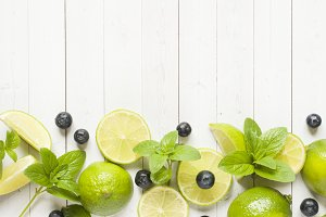 Fresh citrus berries lime mint blueberries on a light background. Copy space for text