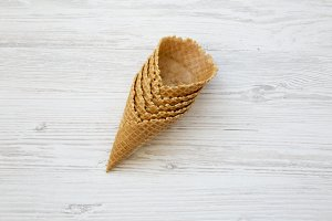 Waffle sweet cones over white wooden