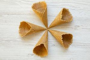 Five ice cream waffle cones on