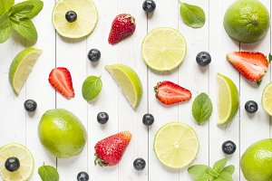 Fresh berries of citrus lime mint blueberries strawberry on a light background. Flat lay summer