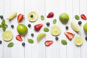 Fresh berries of citrus lime mint blueberries strawberry on a light background. Copy space for text