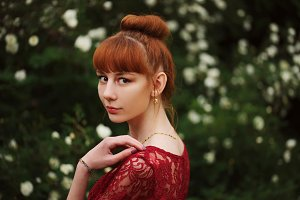 beautiful red haired girl in park