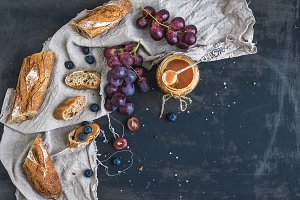 French baguette and red grapes