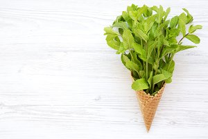 Waffle ice cream cone with mint