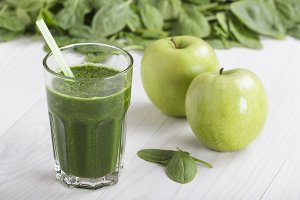 Spinach juice with apple in a soda jug