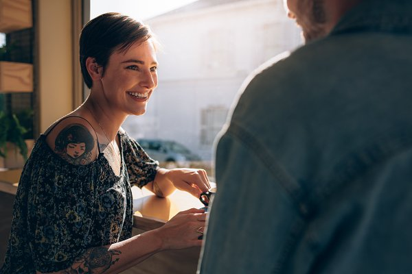 People Stock Photos: Jacob Lund Photography - Smiling couple at coffee shop