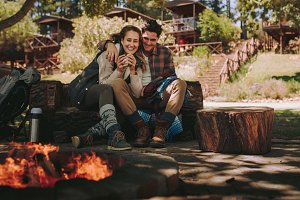 Loving couple resting by a bonfire