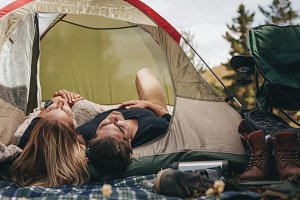 Camping couple sleeping in a tent