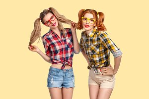 Two Happy Girls Sisters in Plaid Shirt Having Fun