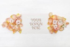 Paper mockup, rose petals flatlay