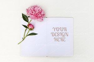 Sketchbook mockup, floral flatlay