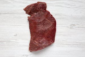 Uncooked raw beef meat on white