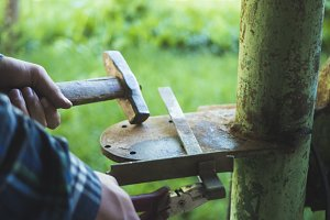 craftsman hands with working tools