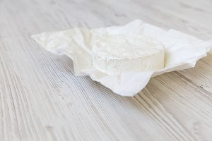 Camembert cheese on paper. Food for