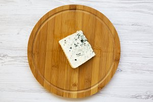 Blue cheese on wooden board. Top