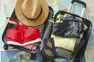 Open traveler's bag with clothing