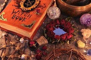 Witch book and magic mirror