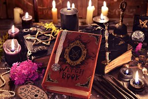 The witch book and black candles