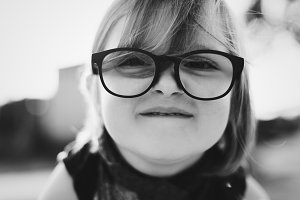 Closeup of little girl with glasses
