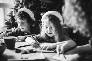 Kids enjoy coloring book christmas
