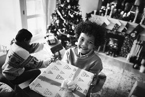 African kid holding a Christmas gift