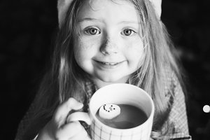 girl enjoying a mug of hot chocolate