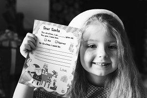 girl holding her Christmas wishlist