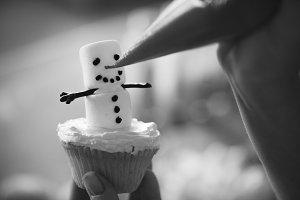Marshmallow snowman cupcake process