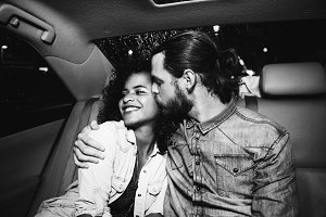 Couple in the backseat of a taxi