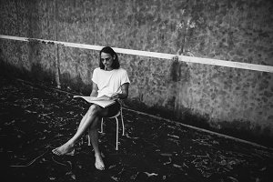 Artsy man relaxing at a tennis court