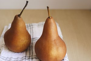 Pears on Natural Wood Table Top