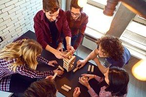 Top view friends play indoor board games