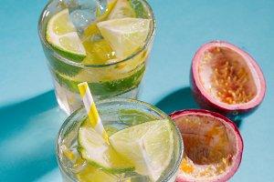 Cold fresh lemonade drink on blue