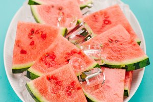 Fresh watermelon slices on ice cubes