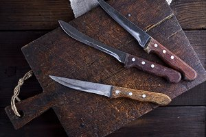 three old kitchen knives