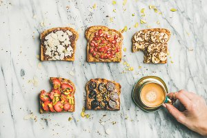 Healthy breakfast with wholegrain toasts , coffee over grey marble background