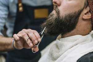 Man arranging his beard.