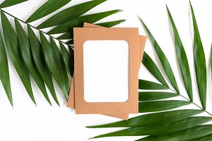 Kraft paper frame and green leaves