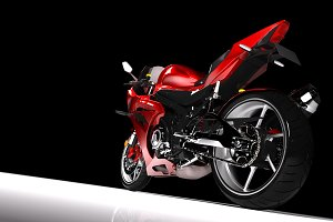 Back view of red sport motorcycle in a spotlight