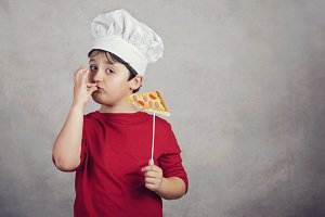 child funny cook with slice pizza