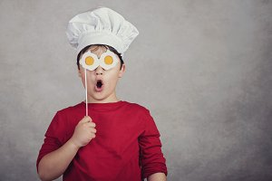 funny child with fried eggs