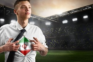 Iran soccer or football supporter showing flag