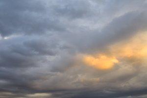 Dark clouds golden sun