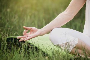 woman meditating on nature